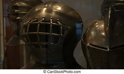 Medieval iron armor of a knight in a museum showcase close up view.