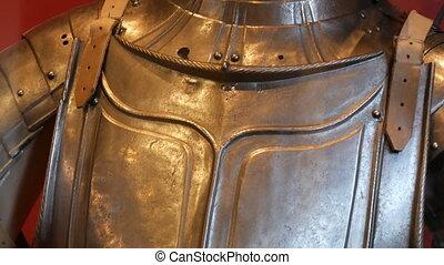 Medieval iron armor of a knight in a museum showcase close...