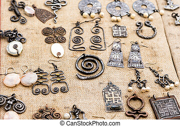 medieval jewelry earrings pendant Celtic patterns on a fabric ba