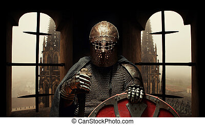 Medieval knight in the armor with the sword and helmet. Castle on the background.