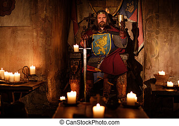 Medieval king on throne in ancient castle interior. - Old...