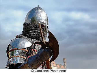 Medieval knight at blue sky backgro