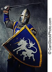 Medieval knight in attack position.