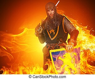 Medieval knight on fire background.