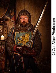 Medieval knight on guard in ancient castle interior.