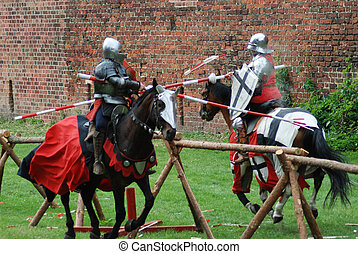 Medieval knights fighting (jousting) at a tournament