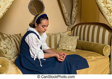 Medieval maid in Golden renaissance bedroom