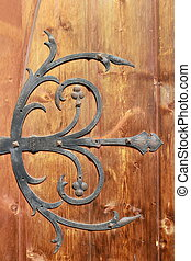 medieval metal decorations on old door