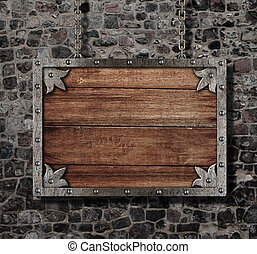 medieval old sign with chain on stone wall
