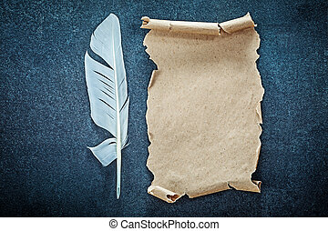 Medieval paper sheet feather on black background