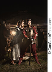 Medieval peasant woman is flirting with the knight