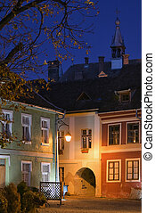Medieval Saxon Fortress Night View In Sighisoara, Transylvania