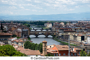 Medieval stone bridge Ponte Vecchio over the Arno River, Florence, Tuscany, Italy.