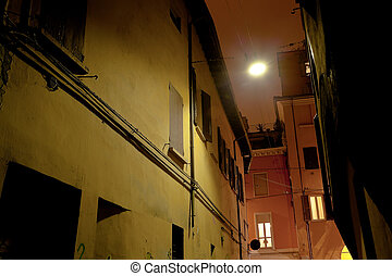 medieval street in Bologna at night