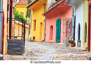 Medieval street view in Sighisoara founded by saxon colonists in