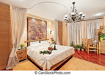 Medieval style bedroom with canopy bed on wide angle view