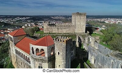 Aerial view on Medieval Templar Knights Castle built on top of a hill, Leiria, Portugal, 4k