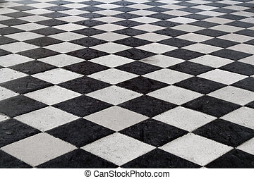 """A medieval black and white tiled floor. Stone texture. Shot at the """"Chenonceau"""" castle, Loire Valley France."""