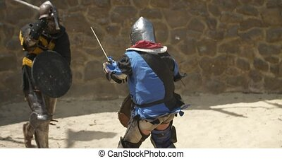 Medieval tournament. Two strong warrior knights fighting at arena