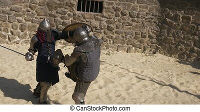 Medieval tournament. Two strong warrior knights fighting at...