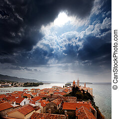 Medieval Town Dramatic Sky - A medieval town with a dramatic...