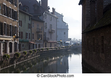 Medieval town of Annecy and river at morning