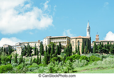 Medieval town of Tuscany over a hill in spring