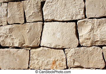 Medieval wall of stone blocks