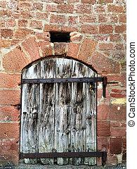 Medieval wall with wooden door