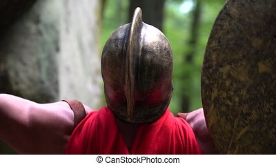 Medieval warrior in the woods - Close up rearview shot of a...