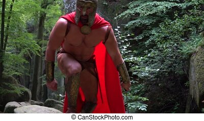Medieval warrior in the woods - Shot of a handsome muscular...