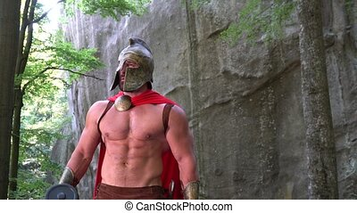 Medieval warrior in working out in the woods - Shot of a...