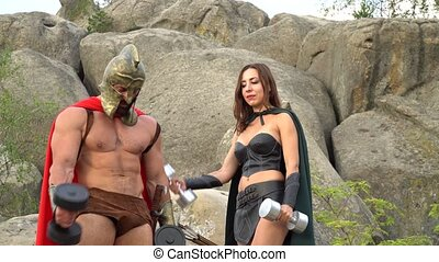 Medieval warrior in working out in the woods with his woman...