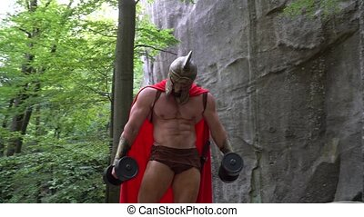 Medieval warrior in working out in the woods - Full length...