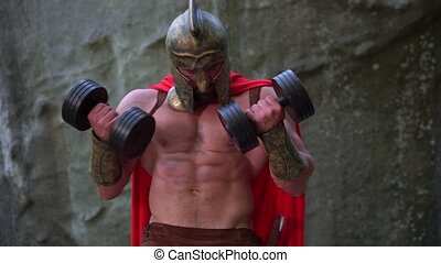 Medieval warrior in working out in the woods - Horizontal...
