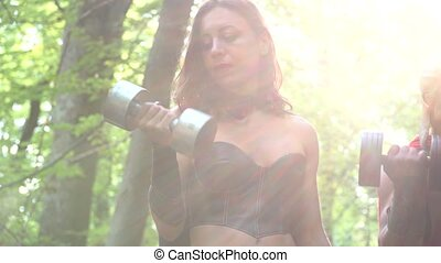 Medieval warrior in working out in the woods with his woman