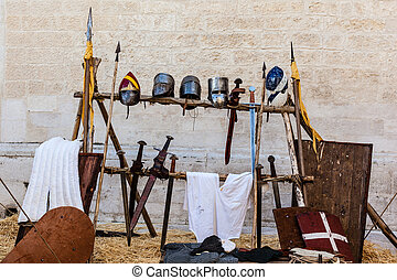 Medieval Weapons - medieval shields, helm and weapons in a...