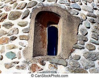 Medieval window on a church wall
