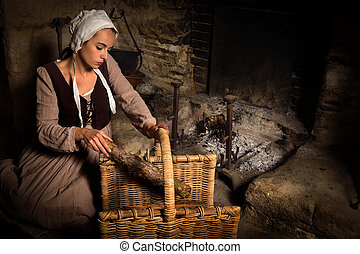 Medieval woman at fireplace