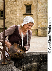 Medieval woman at water well