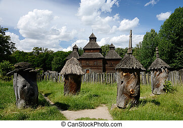 Medieval wooden church with old apiary ,Ukraine,Pirogovo,Europe