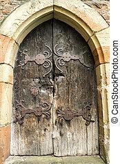 Medieval Wooden Door in Stone Wall.