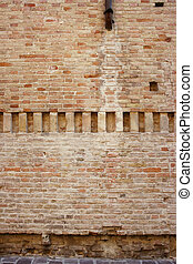 Medioeval wall background with a center line of vertical...