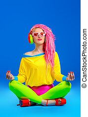 meditating DJ - Trendy bright girl listening to music in...