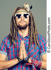 meditating hippie - Portrait of a hippie young man in...