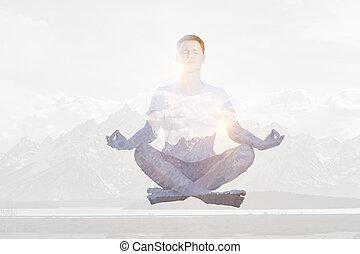 Meditating man multiexposure