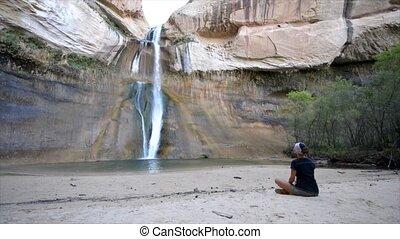 Meditating near the waterfall