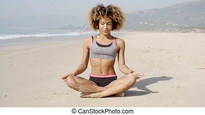 Meditating On The Sea Coast