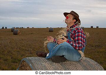 Meditating scarecrow doing yoga.