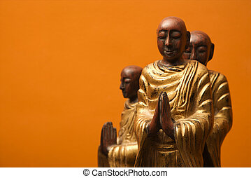 Meditating statues.
